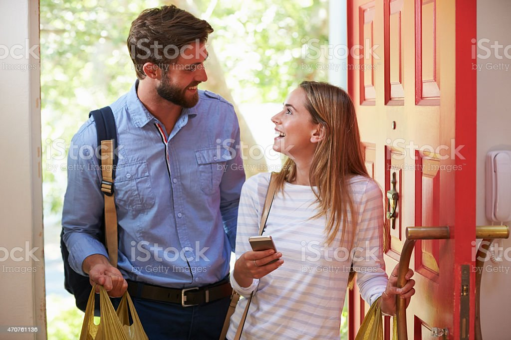 Young Woman Couple Home For Work With Shopping stock photo