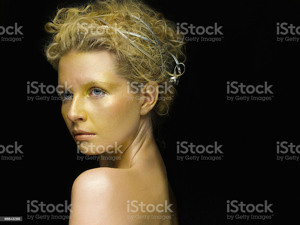 Young woman covered in gold make up royalty-free 스톡 사진