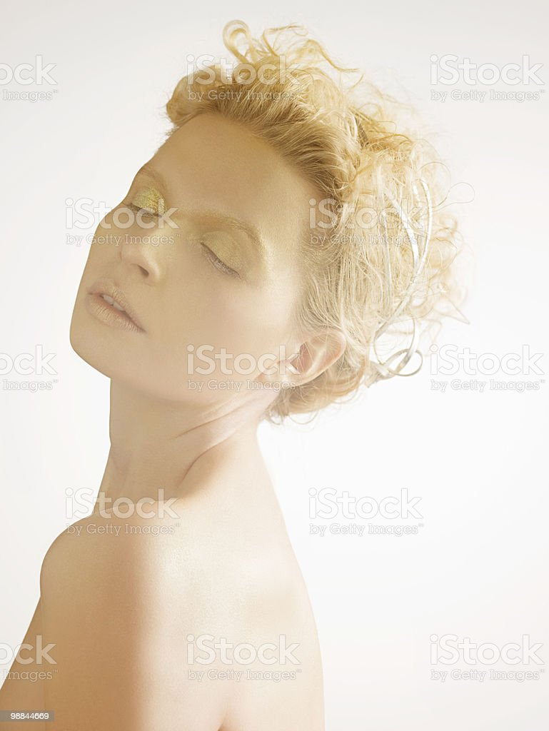 Young woman covered in gold make up 免版稅 stock photo