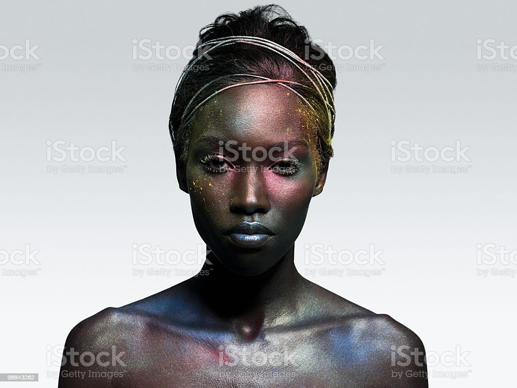 Young woman covered in metallic make up royalty-free 스톡 사진