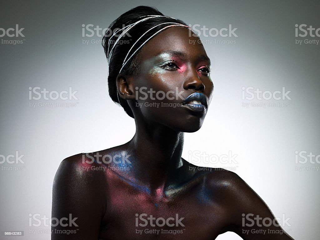 Young woman covered in metallic make up royalty free stockfoto