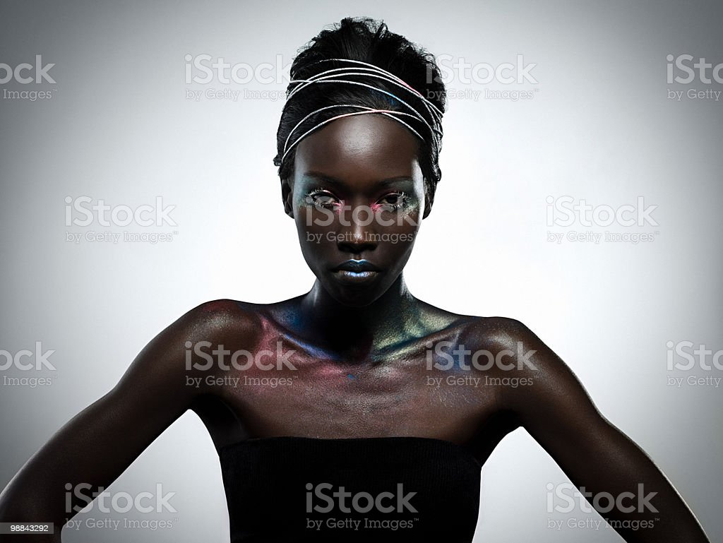 Young woman covered in metallic make up royalty-free stock photo