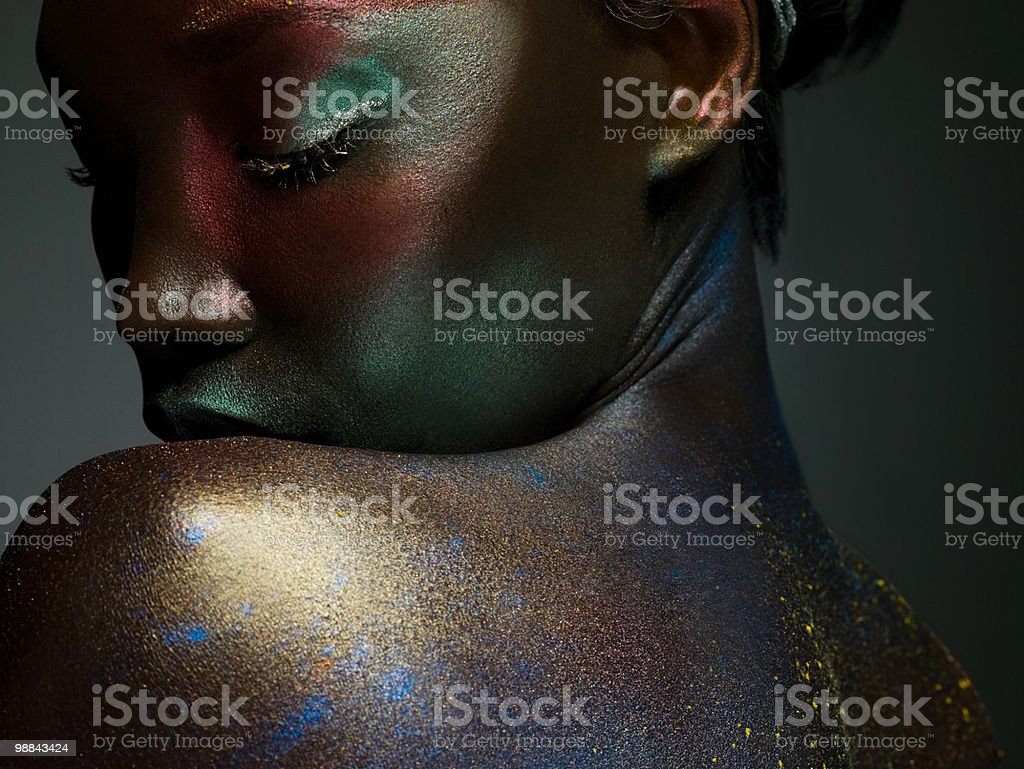 Young woman covered in metallic make up 免版稅 stock photo