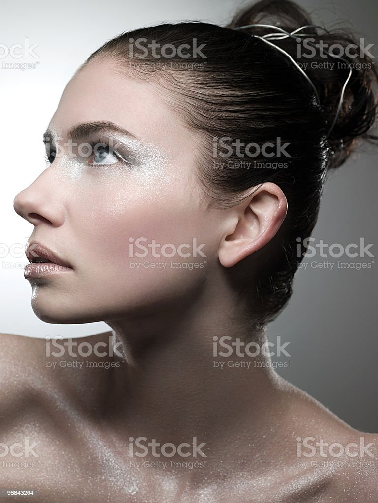 Young woman covered with silver make up royalty-free stock photo