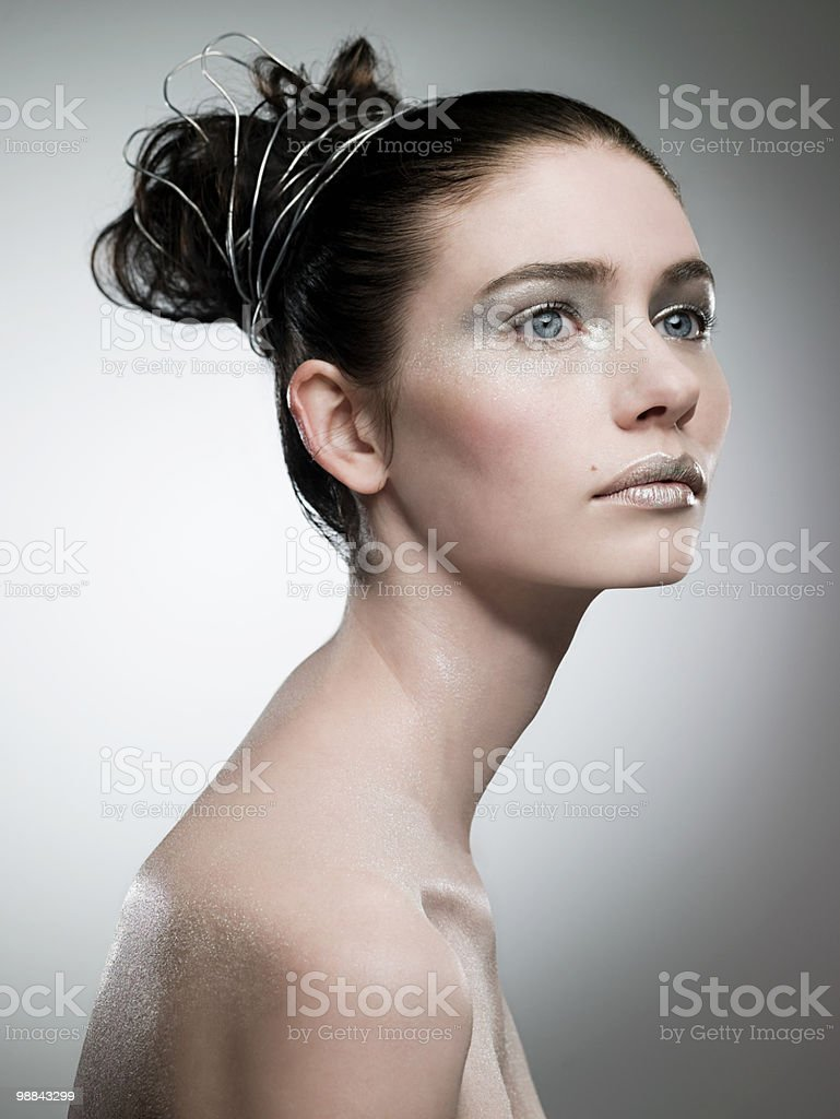 Young woman covered with silver make up royalty free stockfoto