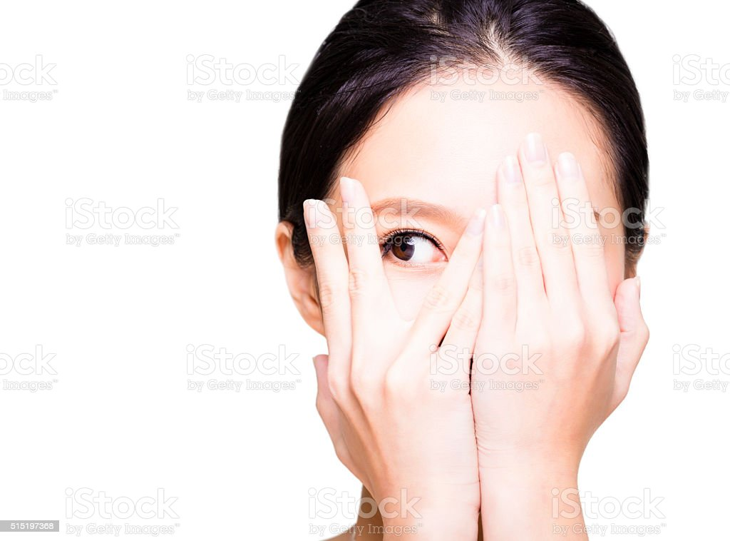 young woman covering her eyes by hands stock photo