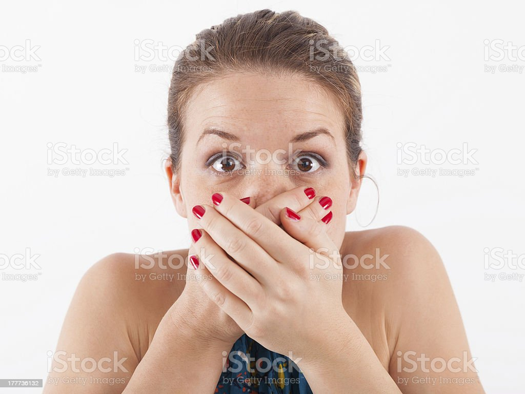 Young woman covering mouth stock photo