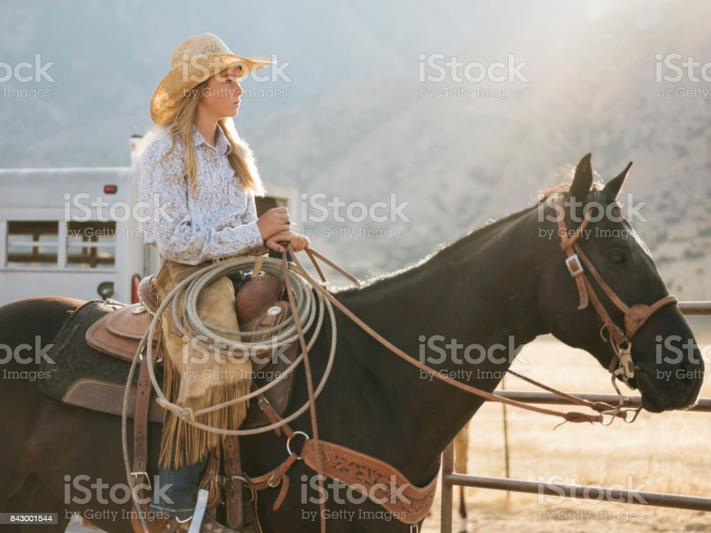 Young Woman Cowgirl With Her Horse stock photo