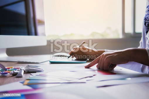 istock Young woman creative designer fashion at work in office. 1069030386