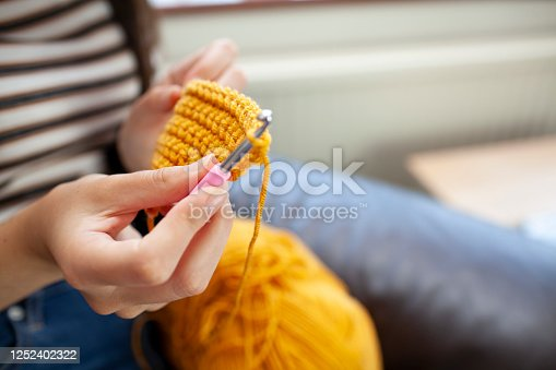 Girl - caucasian, 11 years old - with crochet handmade mask smiling