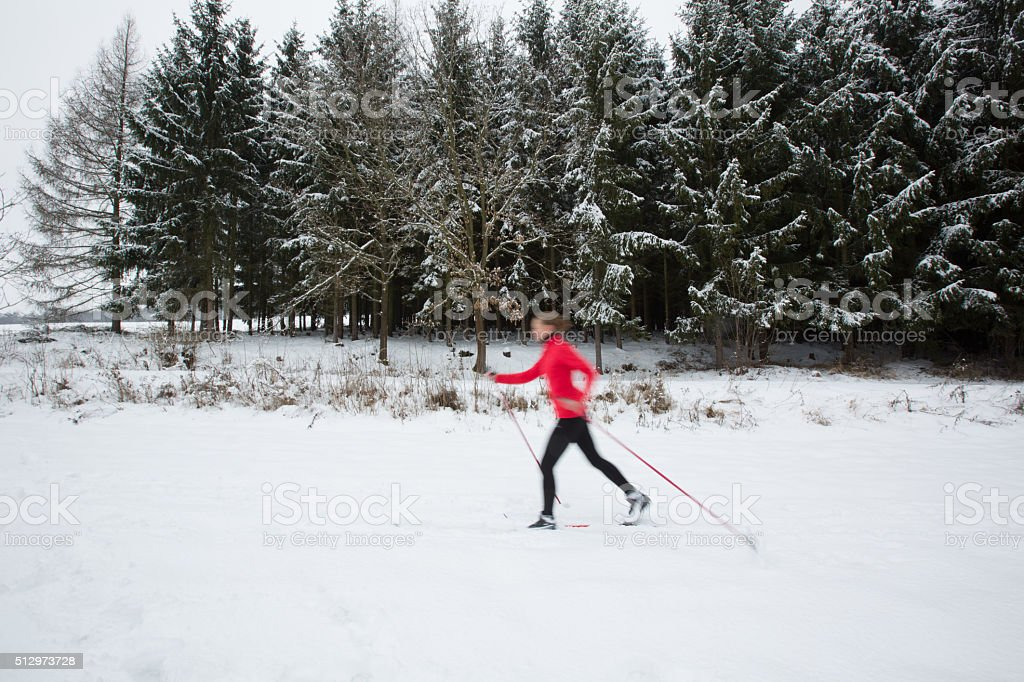 Young woman cross-country skiing stock photo