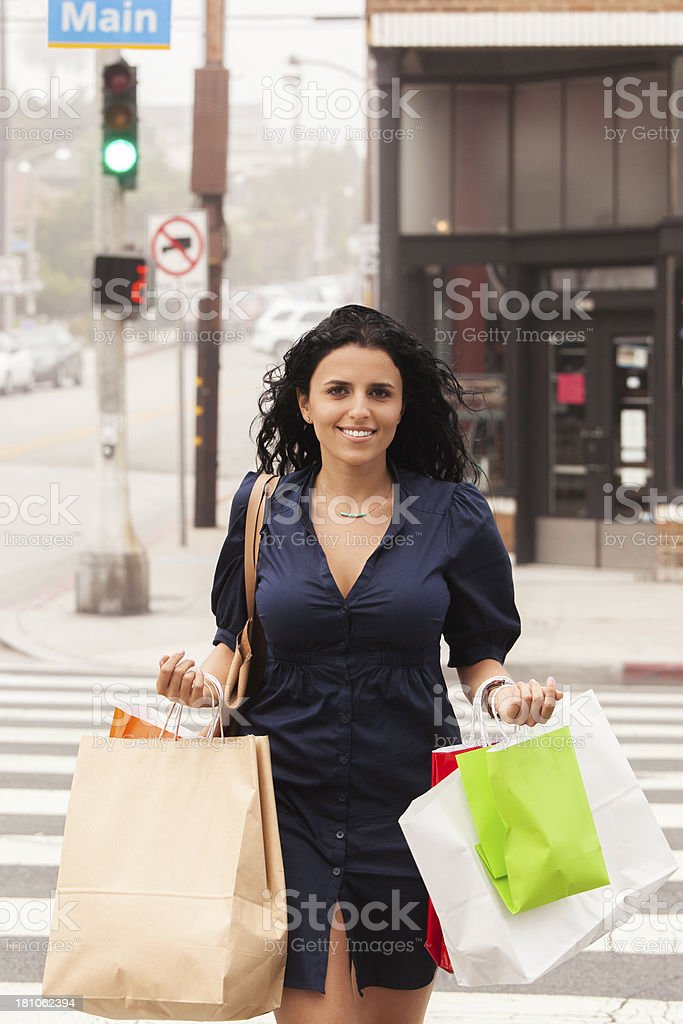 Young woman crossing street royalty-free stock photo