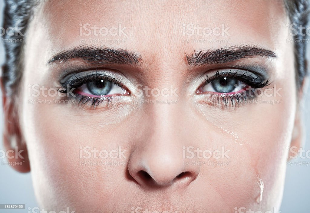 Young woman crying Unhappy young woman looking at the camera and crying. Close up of eyes. 20-24 Years Stock Photo