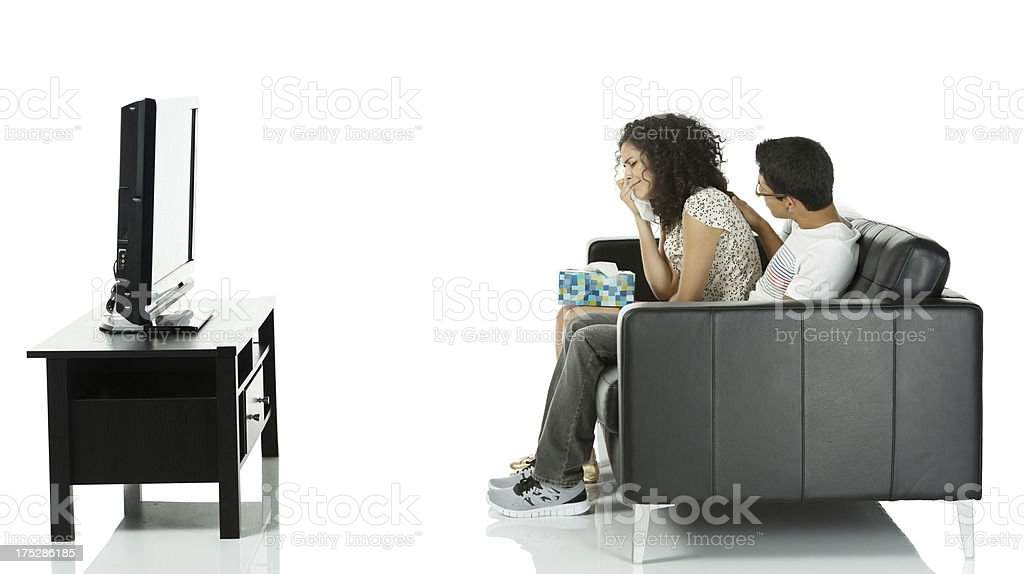 Young woman crying while watching movie royalty-free stock photo