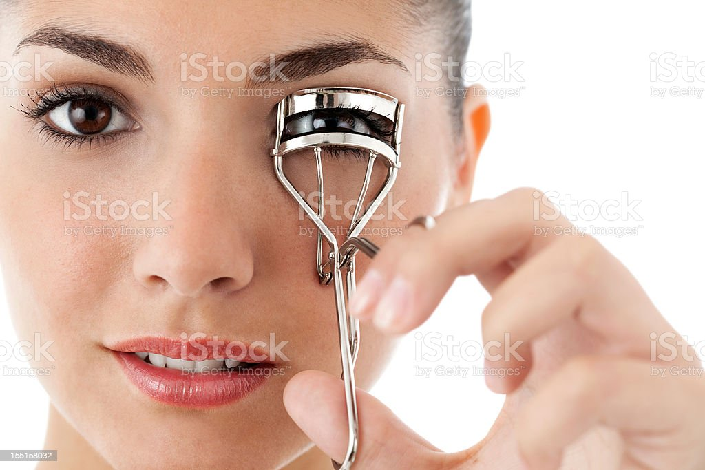Young Woman Curling Her Eyelashes - Isolated
