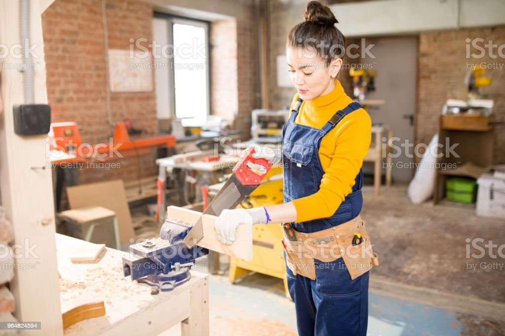 Young Woman  Cutting Wood royalty-free stock photo