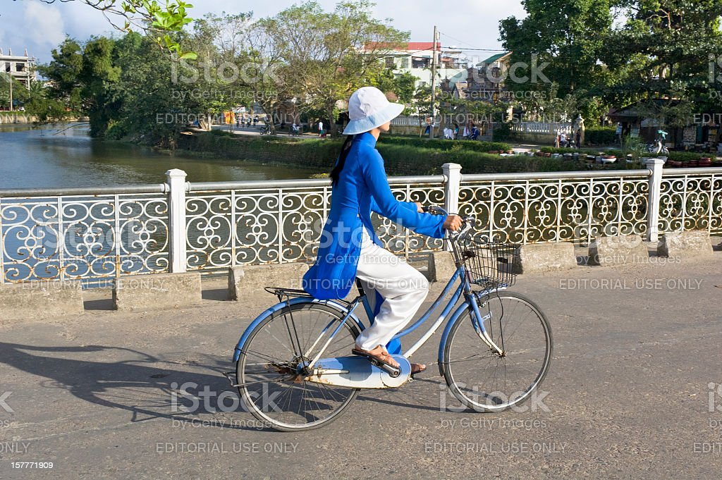 Young Woman Cycling In Hue, Vietnam royalty-free stock photo
