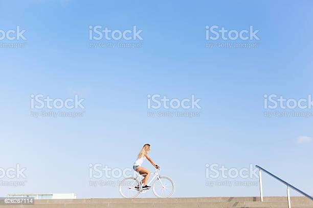 Young woman cycling in the city picture id626267114?b=1&k=6&m=626267114&s=612x612&h=mz r5coydctjen8msuwkdirl3mvl7ozy ci6sz7j9se=