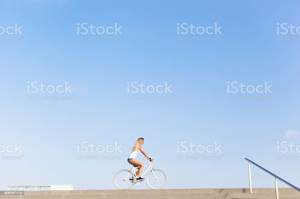 Young Woman Cycling in the City stock photo