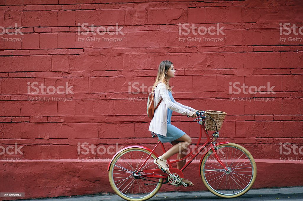 Young woman cycling in the street stock photo
