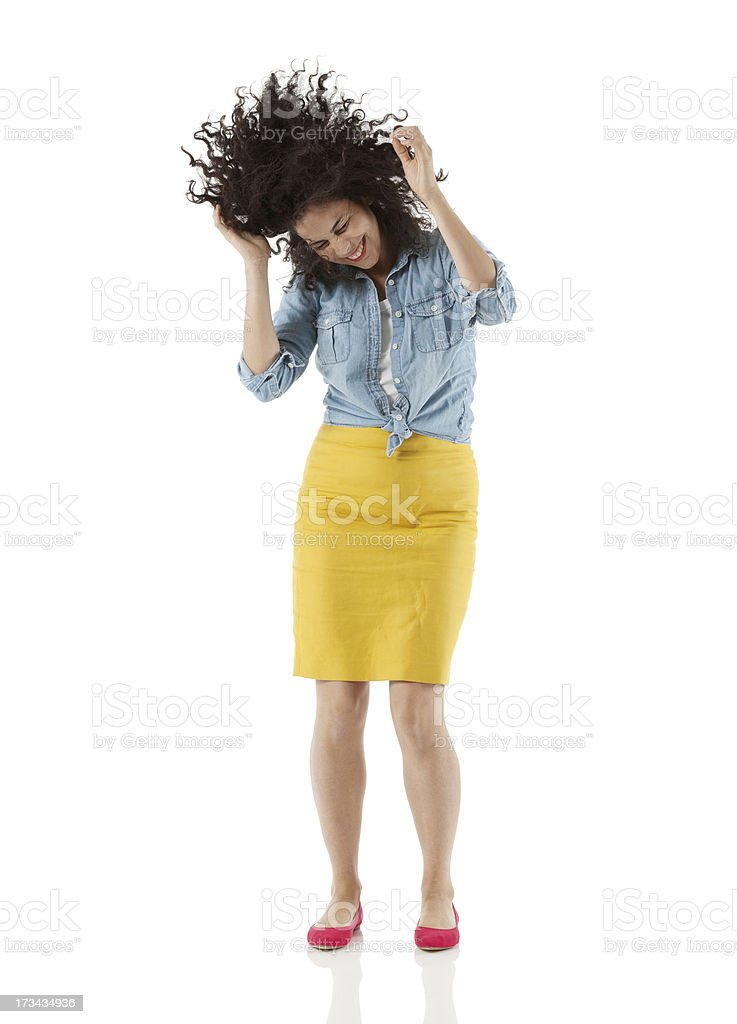 Young woman dancing against white stock photo