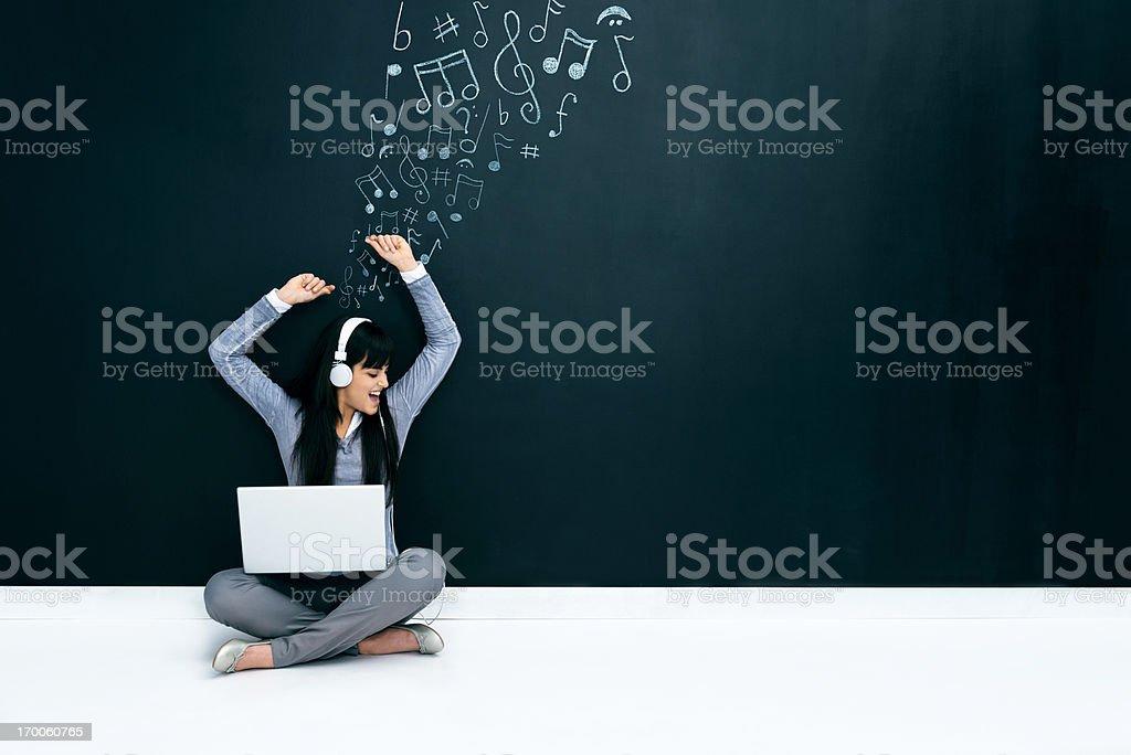 Young woman dancing and enjoying royalty-free stock photo