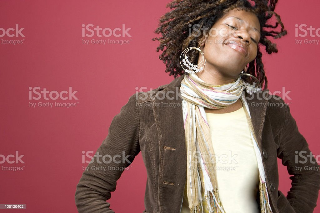 Young Woman Dancing and Tossing Hair stock photo
