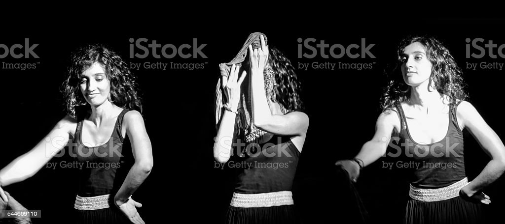 Young Woman Dancing (Pizzica, Folk Dance): Black Background. stock photo
