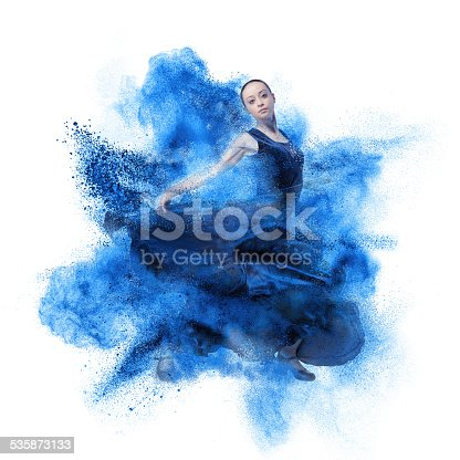 istock young woman dancing flamenco against explosion 535873133