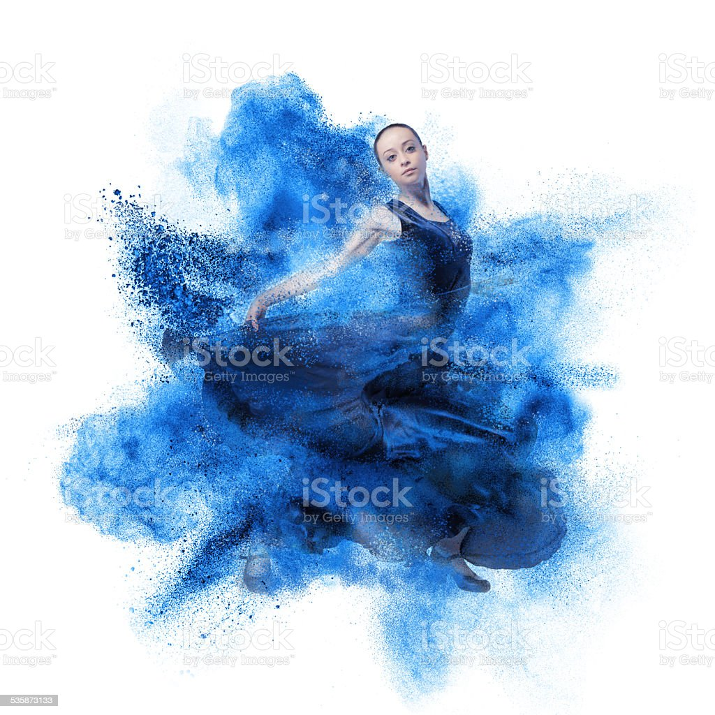 young woman dancing flamenco against explosion stock photo