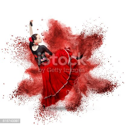 istock young woman dancing flamenco against red explosion 515743397