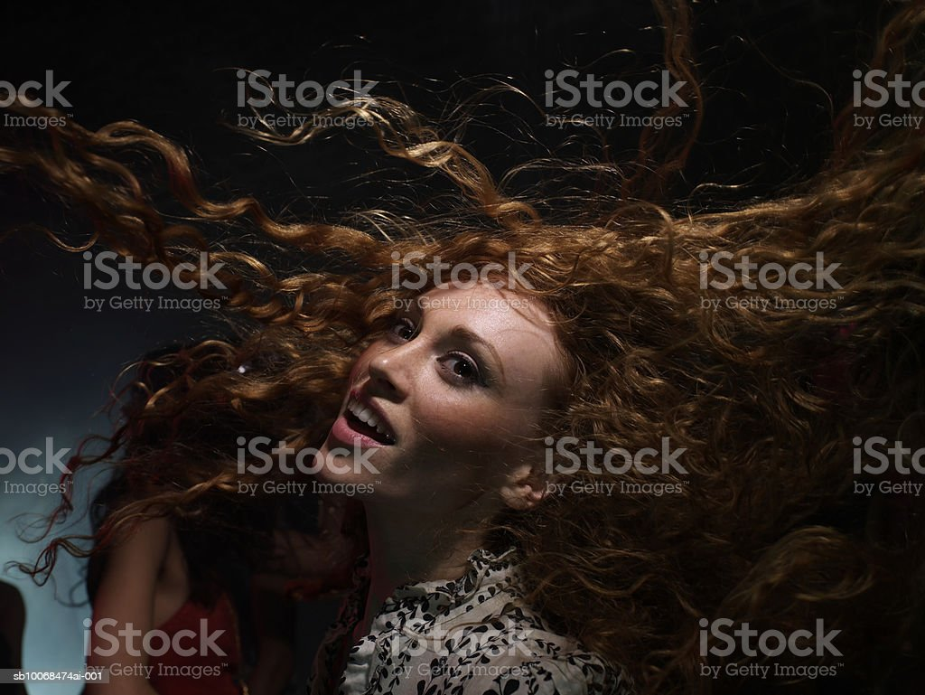 Young woman dancing in night club royalty-free stock photo