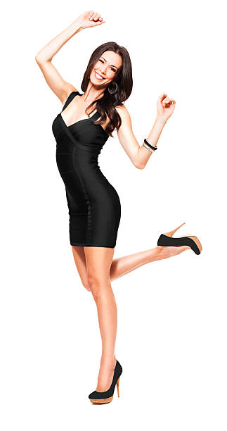 young woman dancing on white - mini dress stock photos and pictures