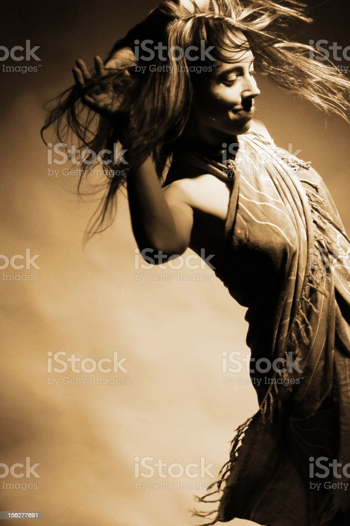 Young Woman Dancing, Sepia Toned royalty-free stock photo