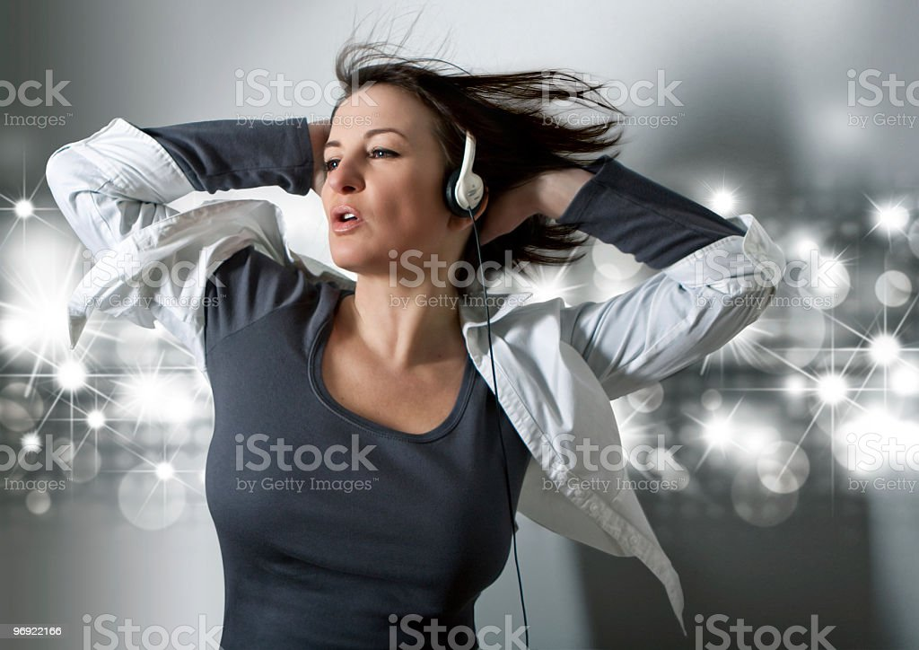 young woman dancing to good music royalty-free stock photo