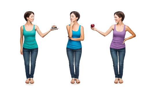Young woman deciding between healthy or unhealthy