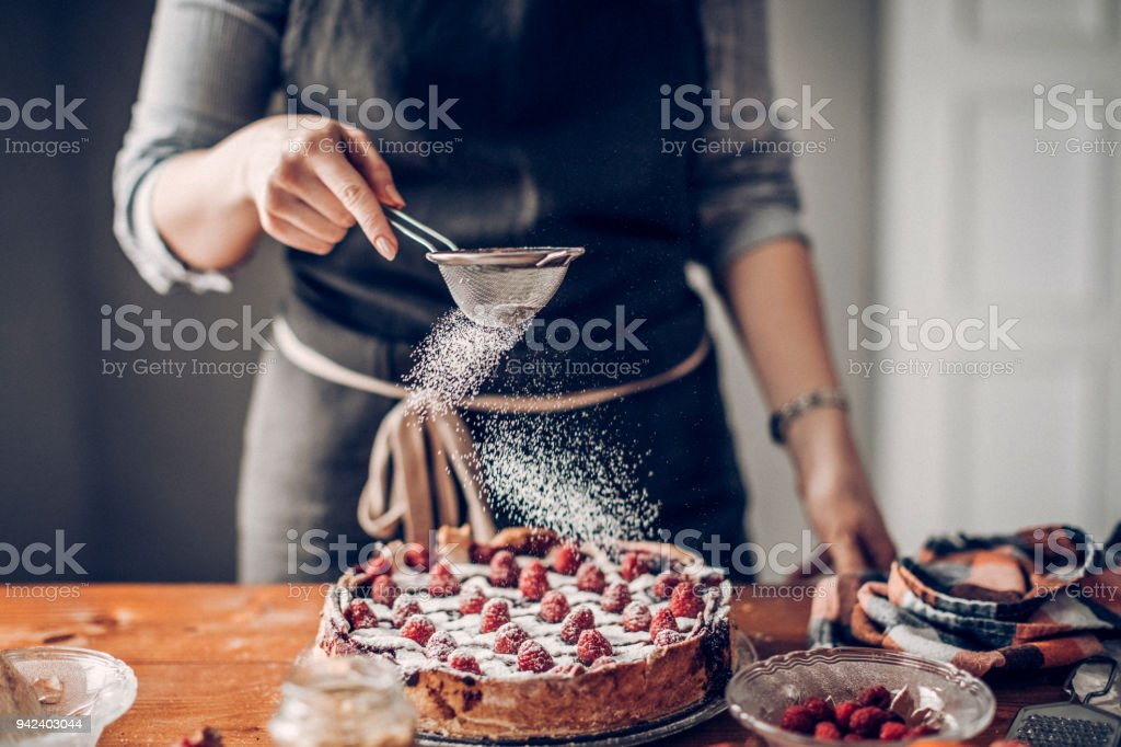 Young woman decorating cake stock photo