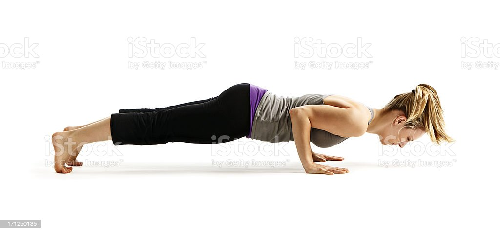 Young woman demonstrating yoga Chaturanga Dandasana (Four Limb Staff Pose) stock photo