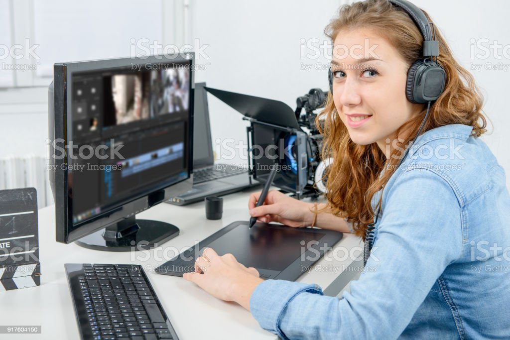 young woman designer using a graphics tablet for video editing stock photo