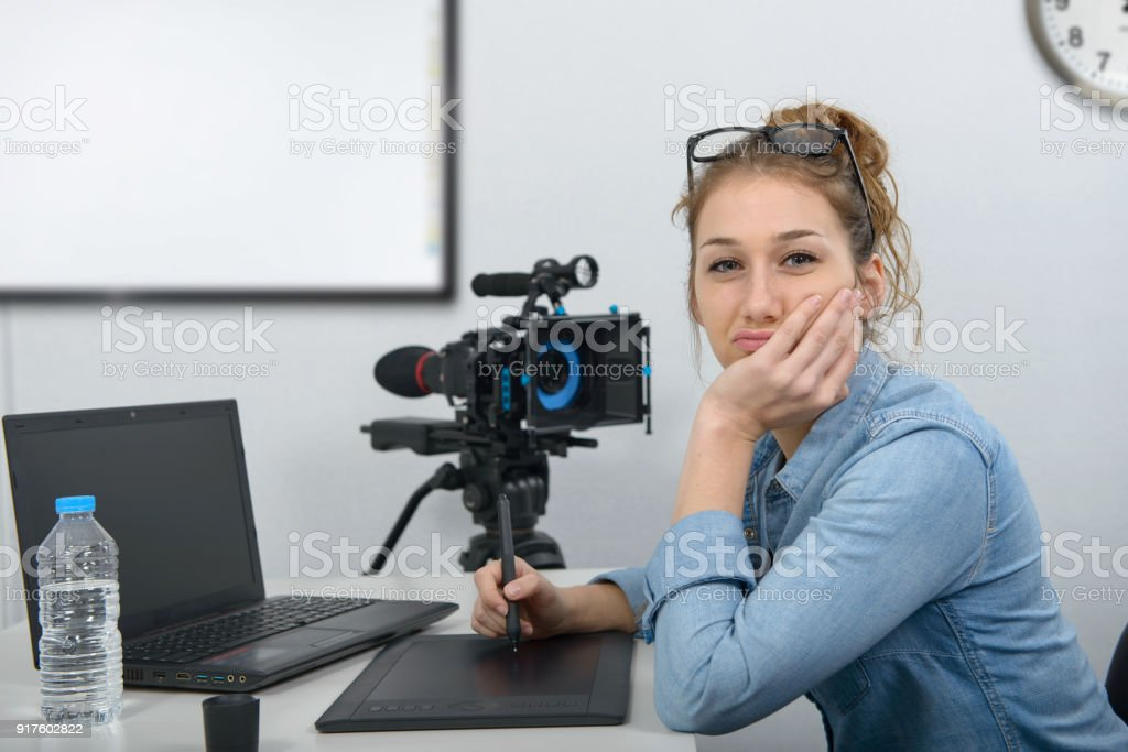 young woman designer using graphics tablet for video editing stock photo