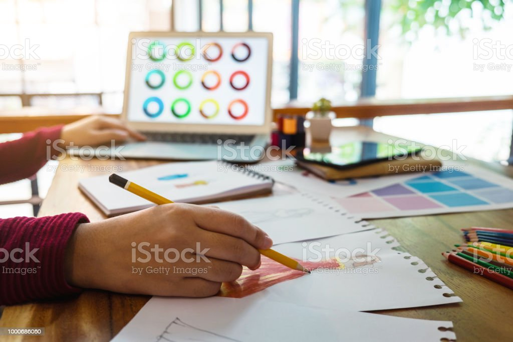 Young Woman Designer Working As Fashion Designers At Work With Fashion Sketches And Color Charts Profession And Job Occupation Fashion Designer Stylish Concept Stock Photo More Pictures Of Architect Istock