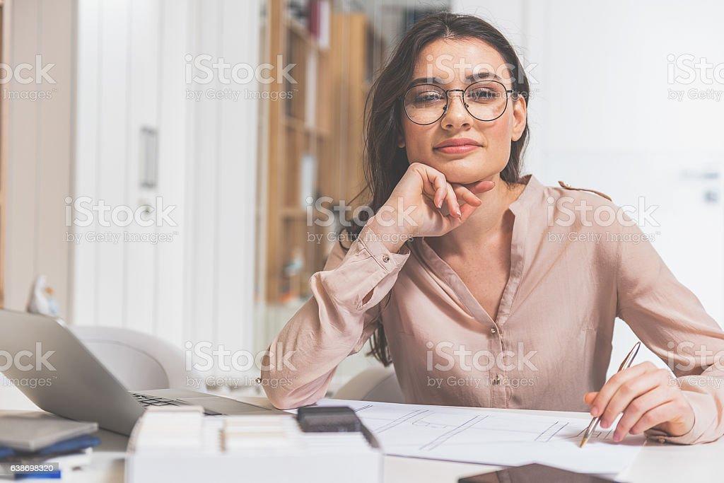 Young woman designing apartment interior stock photo