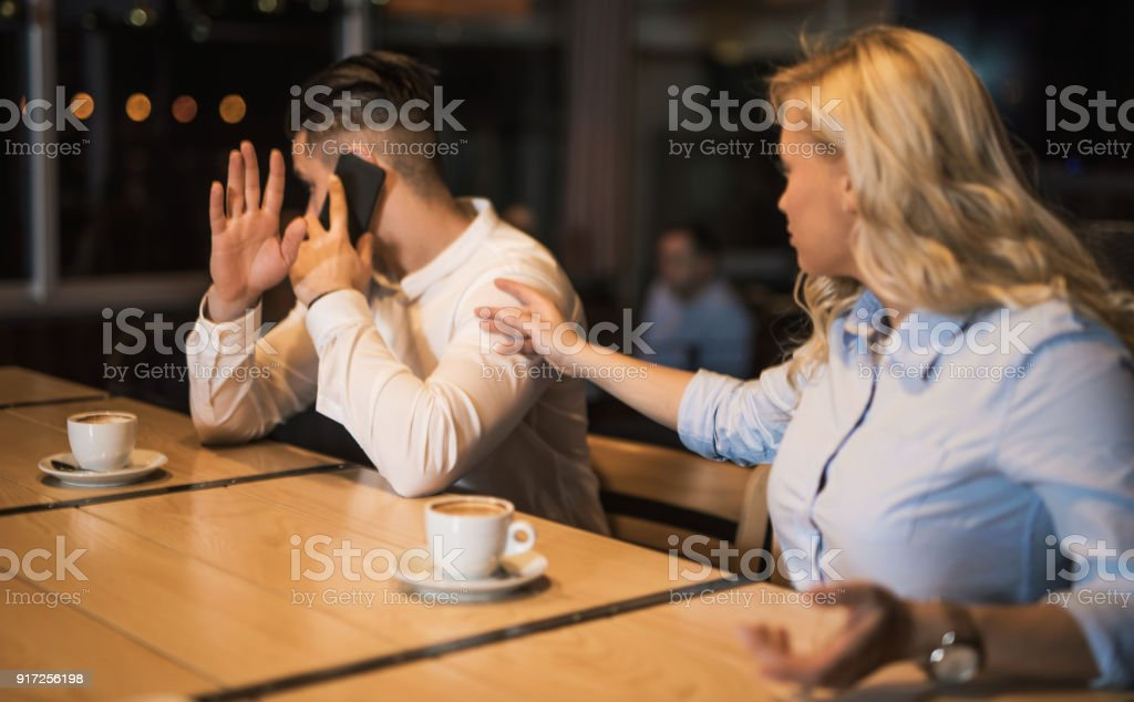Young woman desperately asking for attention. stock photo