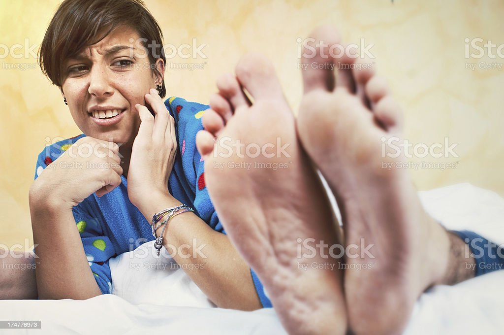 Young Woman Disgusting by Boyfriend's Smell Foot royalty-free stock photo