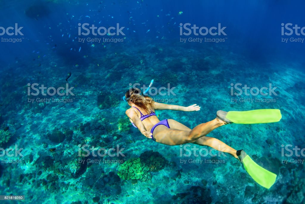 Young woman diving underwater stock photo