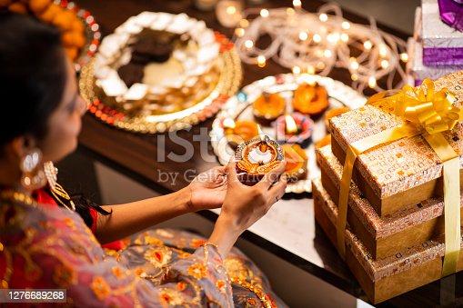 istock Young woman diwali celebrate - stock photo 1276689268