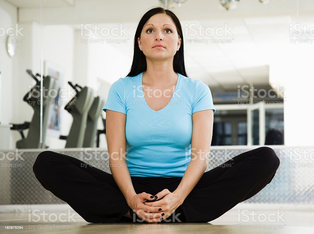 Young Woman Doing a Groin Stretching Exercise stock photo