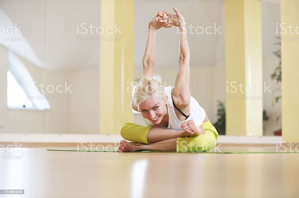 young woman doing agni stambhasana royalty-free stock photo
