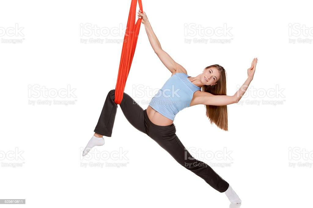 Young woman doing anti-gravity aerial yoga stock photo