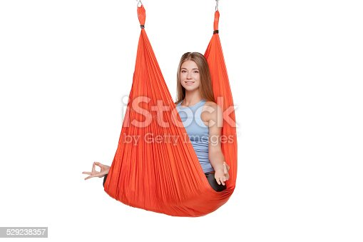 istock Young woman doing anti-gravity aerial yoga 529238357